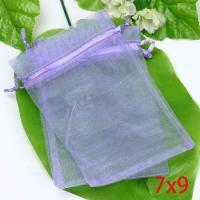 Gratis organza gift zakje voor usb stick. Kleur licht paars